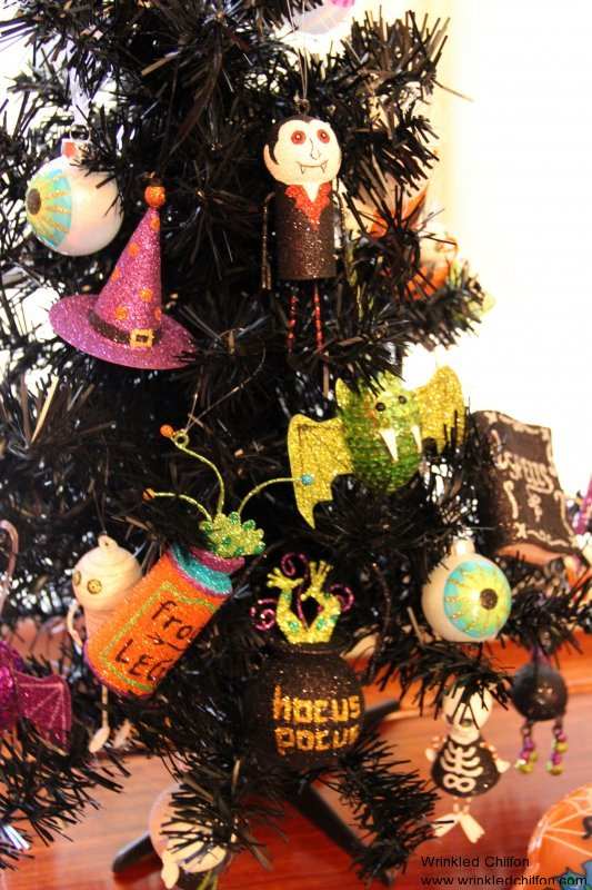 the pumpkin sitting atop the tree just like a little angel and my favoritescount dracula and a sparkly ghost - Halloween Tree Decorations